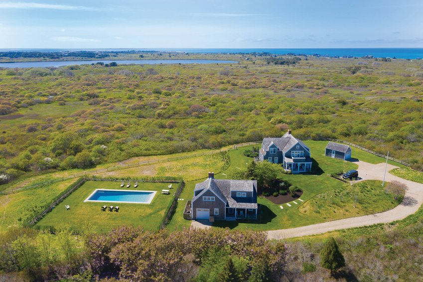 Bordering conservation land and just a short distance from quiet, calm, family-friendly beaches, this Fintry Lane property is situated on a sprawling 1.84-acre lot in the heart of Dionis on the island's north shore.
