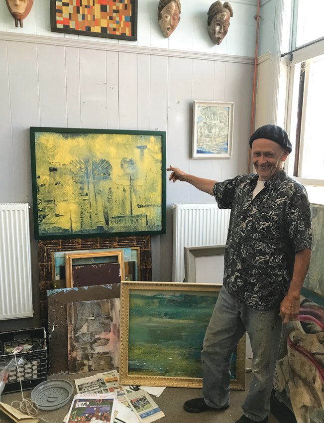 David Bradstreet Wiggins in his New Hampshire studio with one of his abstract expressionist works.