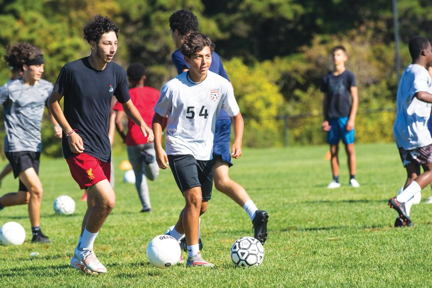 Alejandro Chacon and Jose Aguilar during boys soccer practice drills at Nantucket High School Tuesday.
