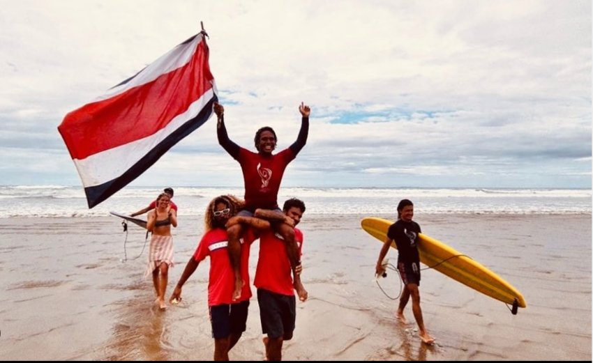 Dorian Torres celebrates on a Nicaraguan beach after winning the individual longboard title at the Central American Surfing Championships.