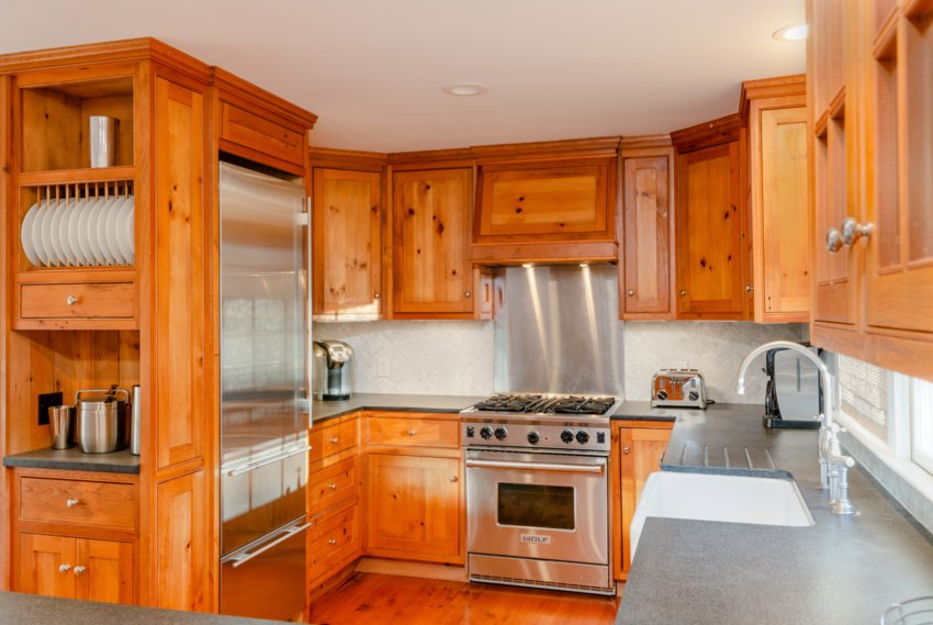 The gourmet kitchen has custom wood cabinetry, granite countertops and high-end stainless-steel appliances by Wolf and Sub-Zero.