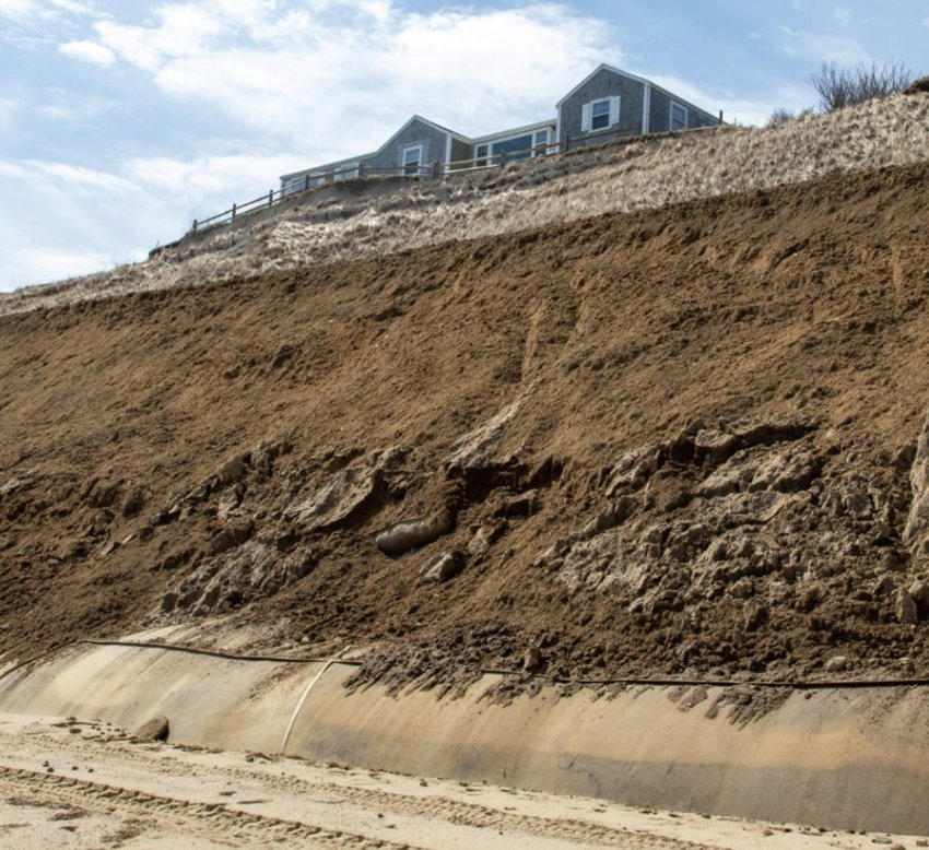 This photo, showing the geotextile tubes at the toe of the Sankaty Bluff, partially covered with sand, was taken in March 2020. Proponents say the geotubes have been effective in preventing further erosion of the bluff in the area where they have been installed.