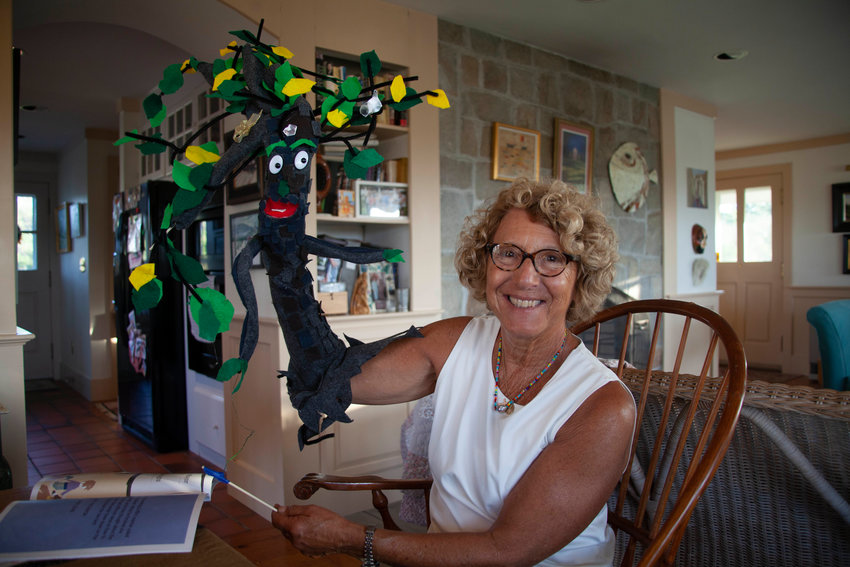 """Maria Zodda with the Elvira the Elm puppet she created to accompany her new children's book, """"Griffin Saves His Tree."""""""