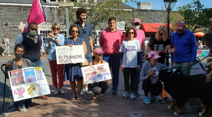 About 30 people participated in a rally to support women's reproductive rights Saturday outside the Nantucket Town & County Building.