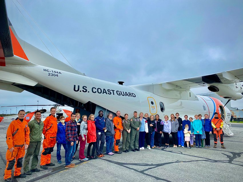 Emergency Department clinicians from Nantucket Cottage Hospital met with aircrews from U.S. Coast Guard Air Station Cape Cod on the island Monday to familiarize themselves with Coast Guard aviation transport.