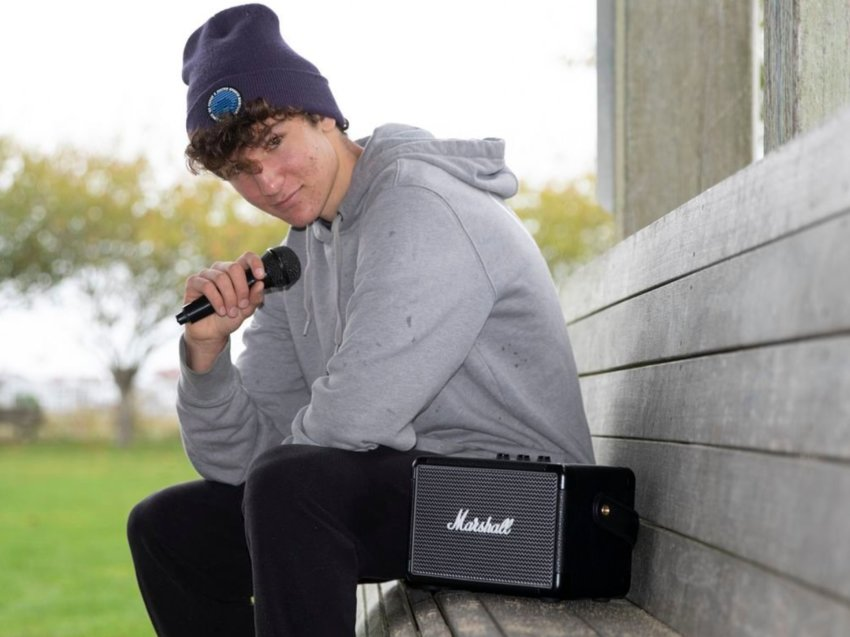 Aspiring Nantucket rapper Joseph Costanzo, 16, with the tools of his trade at the Children's Beach bandstand.