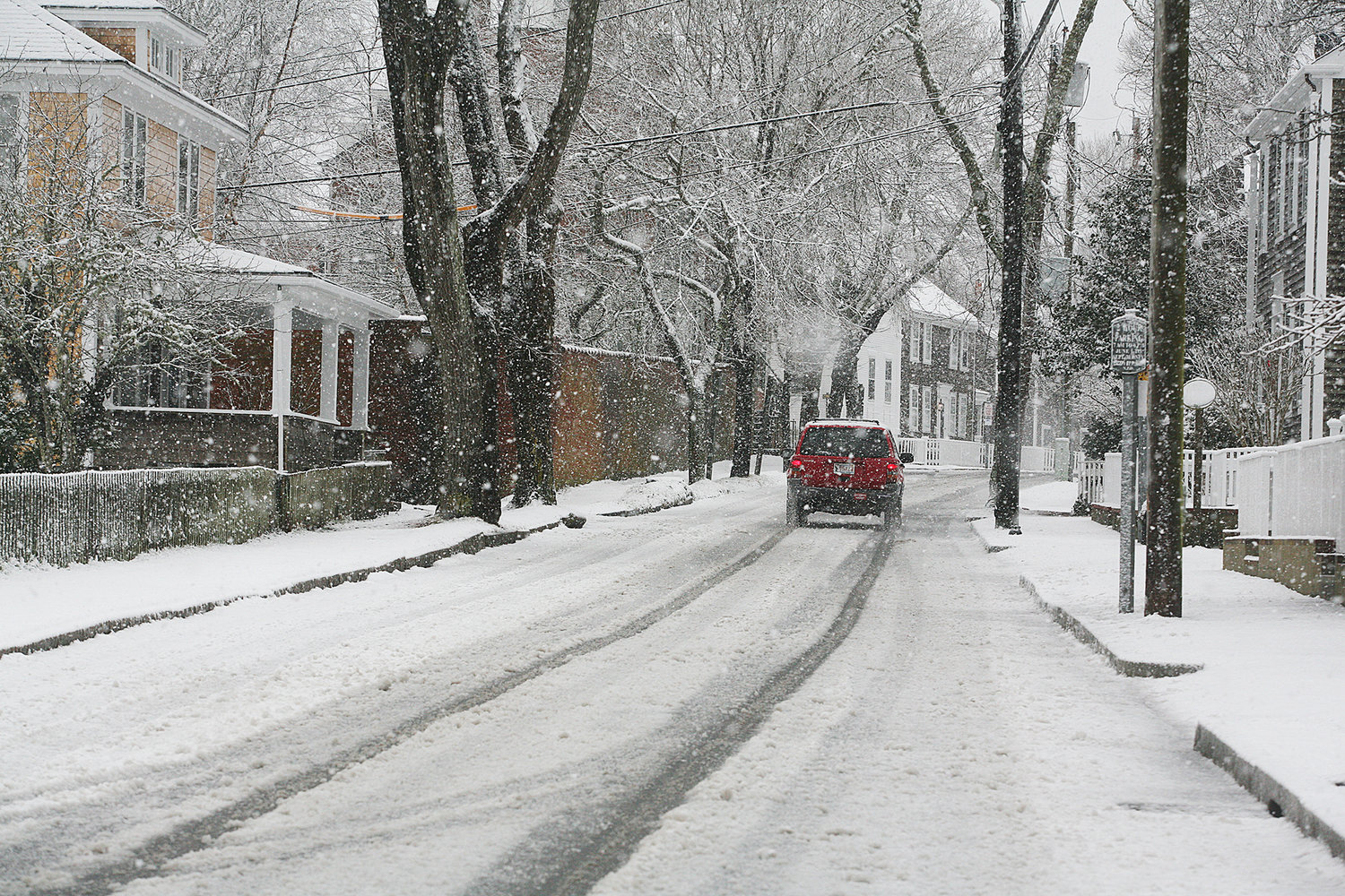 WINTER SCENES -- February 7, 2021 --A vehicle makes it's way along Pleasant Street during Sunday's snow storm.  Photo by Ray K. Saunders