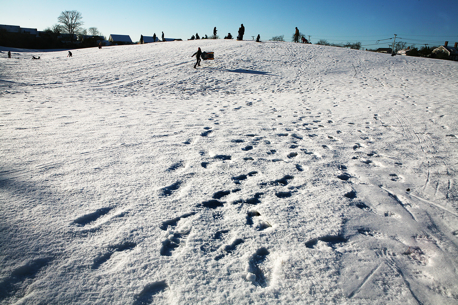 MONDAY, FEBRUARY 8, 2021 -- Footprints in the snow and sledding off Quaker Road on Monday following Sunday's snow storm. Photo by Ray K. Saunders