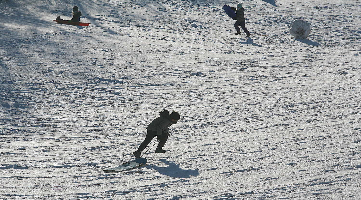 MONDAY, FEBRUARY 8, 2021 -- Sledding off Quaker Road on Monday following Sunday's snow storm. Photo by Ray K. Saunders