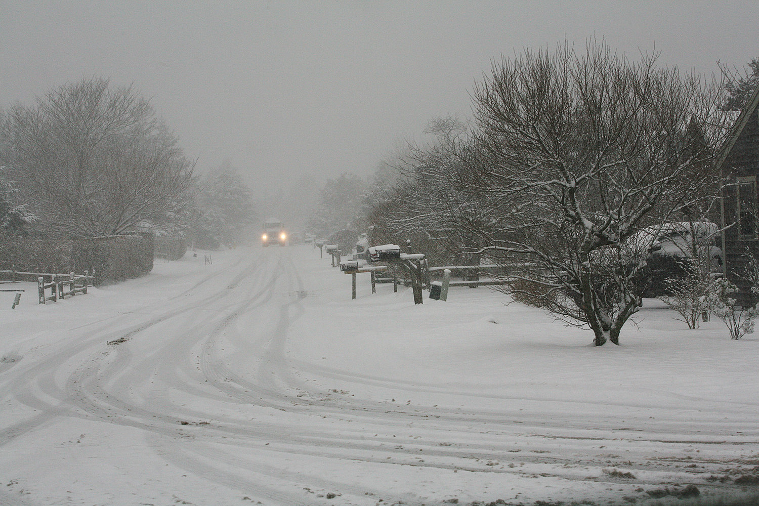 Snow blankets a road off Surfside Road near the schools.