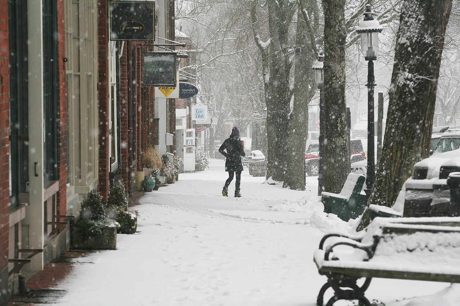 A pedestrian on Main Street during Thursday's snow.