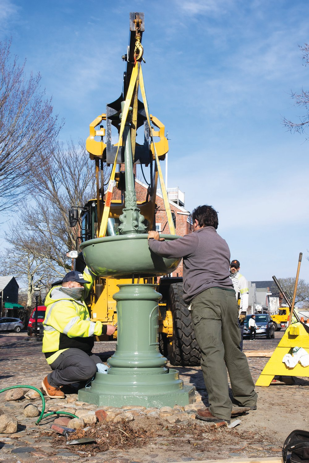 The Max T. Wagner horse fountain returned to its rightful place at the foot of Main Street last Thursday, a little over a year after a driver smashed into it, knocking it down, claiming he was blinded by the sun and didn't see it.