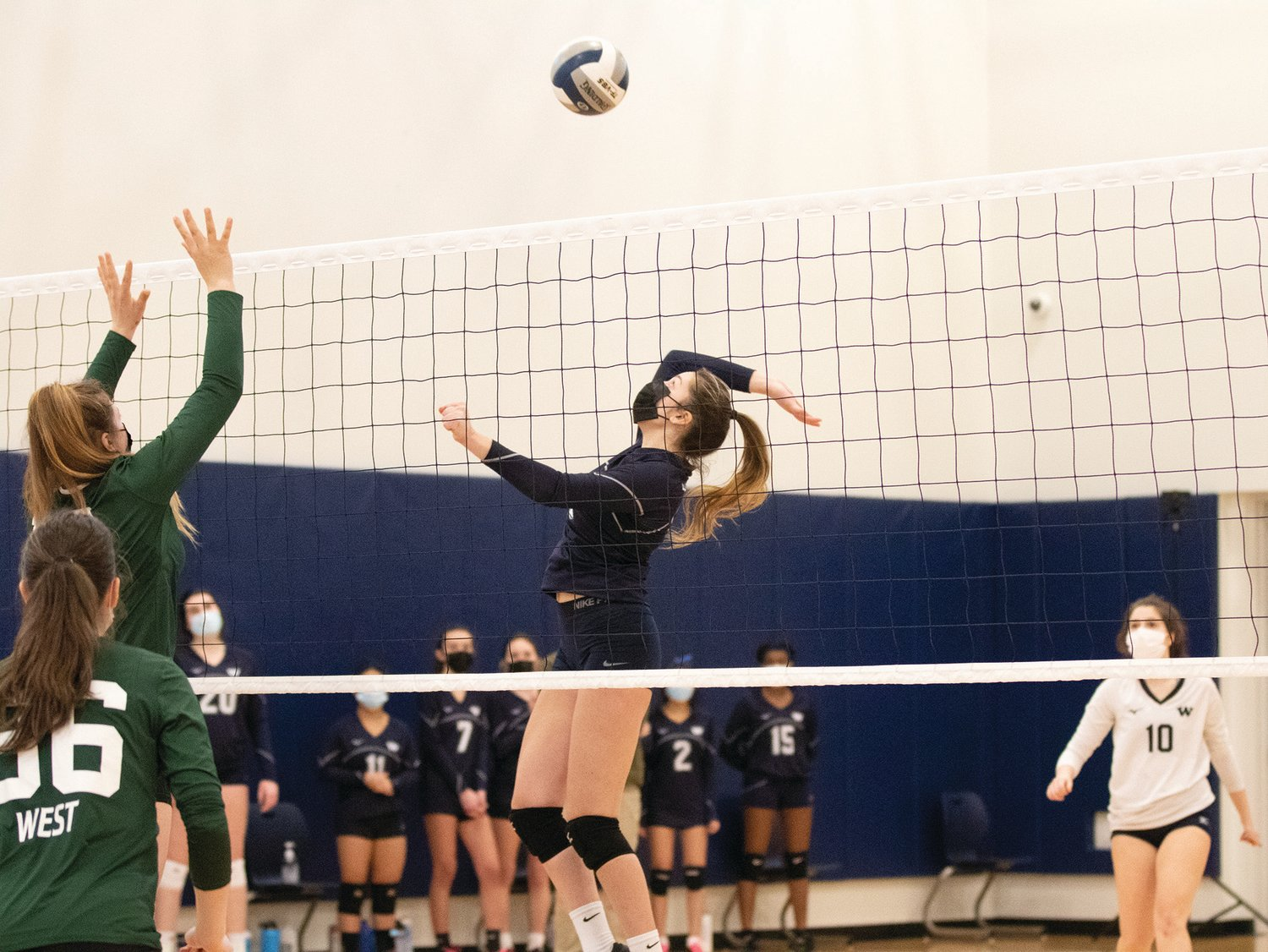 Kaline Natcheva jumps to spike the ball against Sturgis West