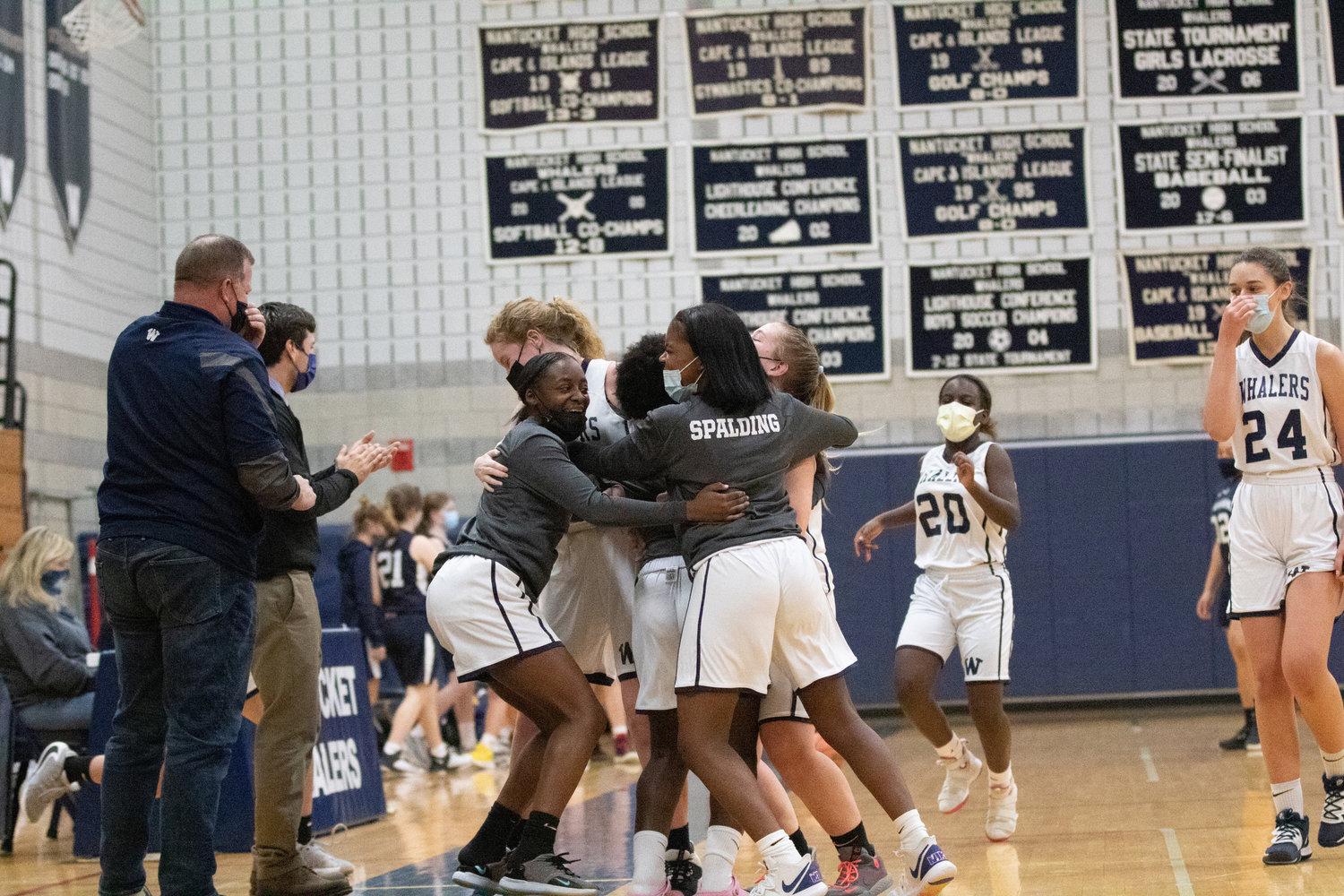 Lady Whalers celebrate first win of season