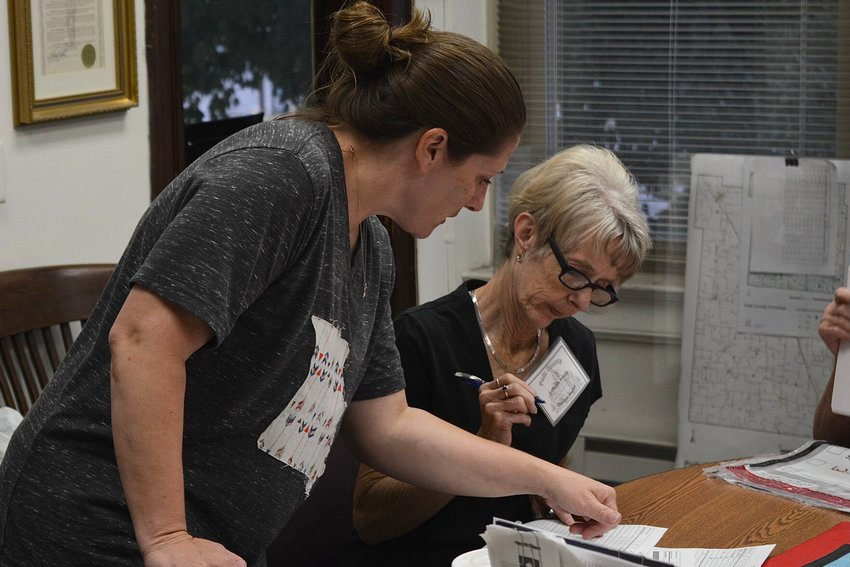 County clerk Rachel Lightfoot and election workerLaNelda Presley begin looking over Tuesday's election results. This was Lightfoot's first election since being elected to office.