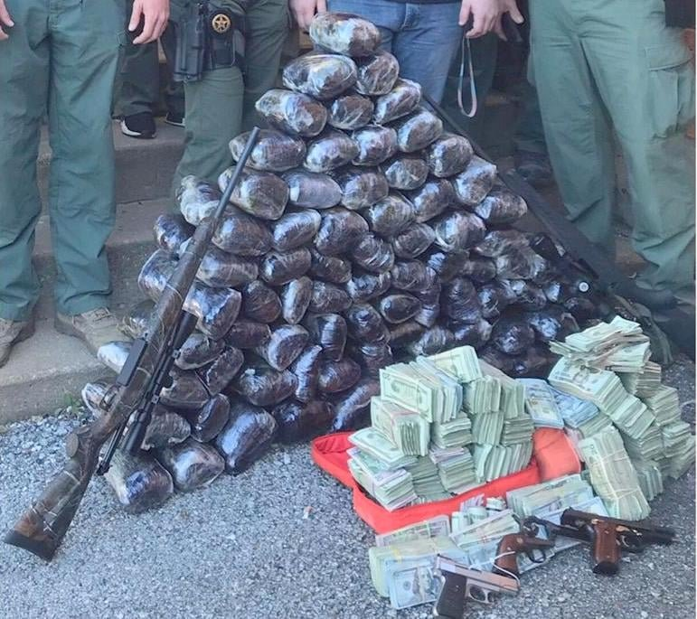 The Oklahoma Bureau of Narcotics shared this photo of drugs, weapons and money seized in connection with the case.