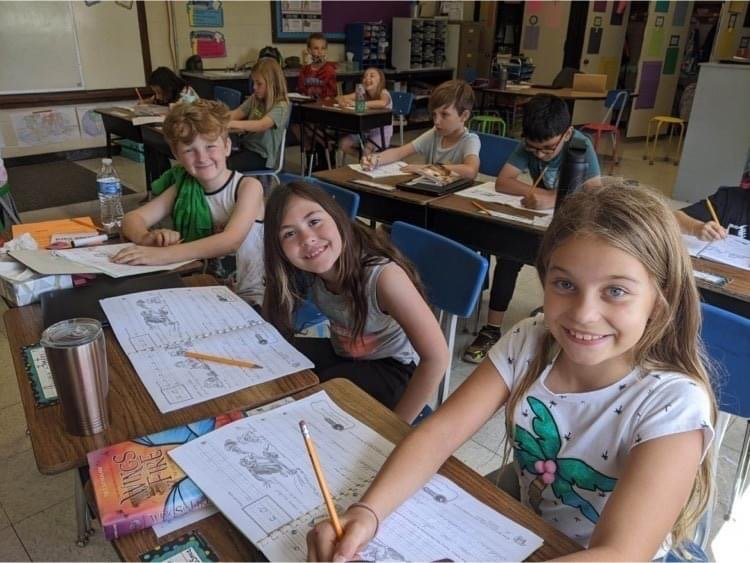 Marion C. Early third graders use their notebooks to practice cursive writing.