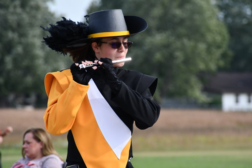 Lily Altic on the flute marches with the Pleasant Hope Pirate Power Band.