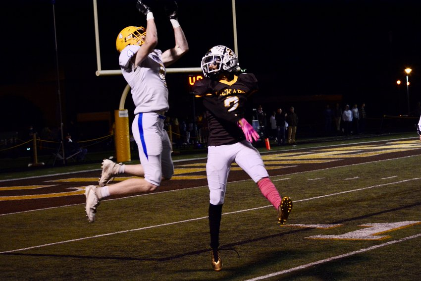 Liberator Josh Bowes flies high to catch the pass that leads him to taking three Chiefs with him into the end zone.