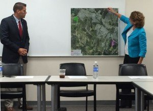 Supervisor Pete Candland (Gainesville) and Supervisor Jeanine Lawson (Brentsville) present a map highlighting the land swap at a press conference Tuesday.