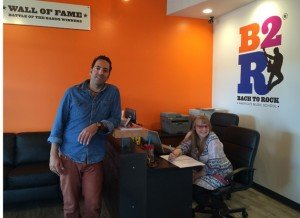 Director Samir Moussa and employee Katie, greet potential students at Bach2Rock, Bristow.
