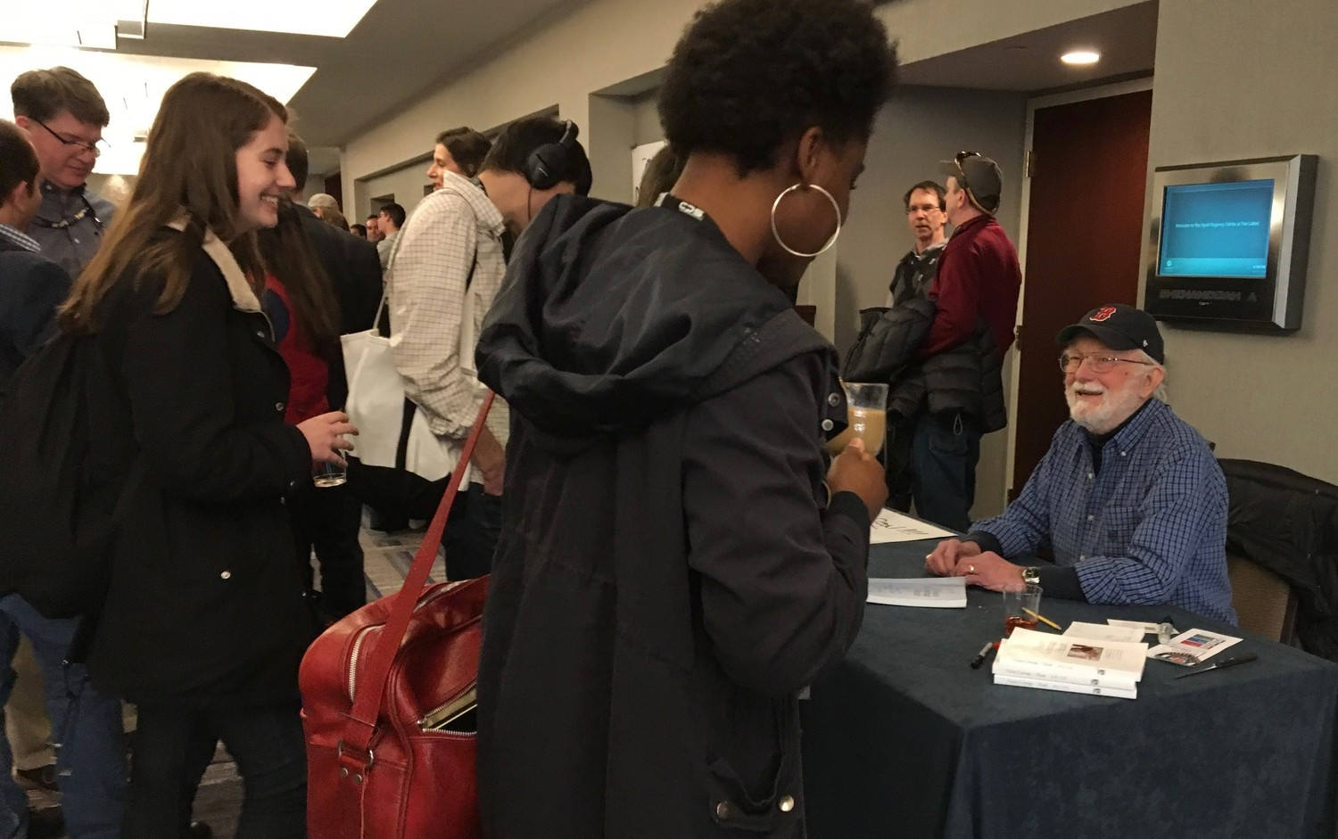 Bob Lynn, author of Vision, Courage & Heart (at the recent Northern Short Course in Fairfax, VA,) signs his book for participants. He signed 75 books during the conference.