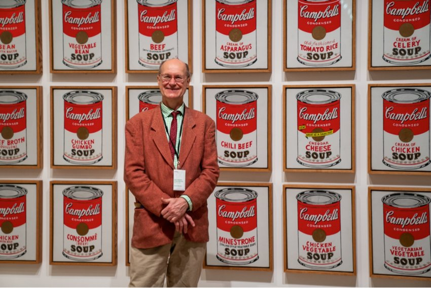 James Warhol (nephew of artist Andy Warhol) with Warhol's Campbell's Soup Cans at the Whitney Museum.