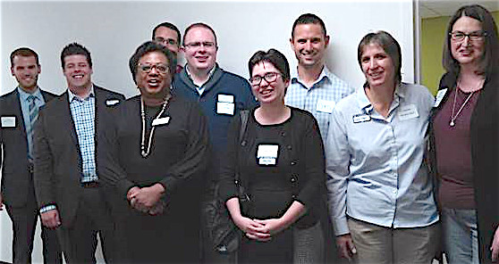 Alder Health Services enjoys new digs at 100 S. Cameron St., Harrisburg. The LGBT Health, HIV, and Mental Health agency's popular Wall of Heroes, a curated collection of photographs of recent history's movers and shapers, is viewable on the agency's public-area hallways. Shown here: Browne, third from the left, with board members and guests at an open house. Central Voice photo