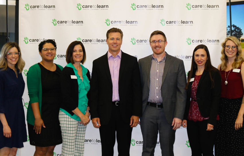 From lefttoright Melissa Rea, Jhasmine Watson, Heather Trinca, Doug Pitt, Christian Mechlin, Annie Mayrose and Michelle Houghton at Care to Learn's 10-year anniversary press conference.