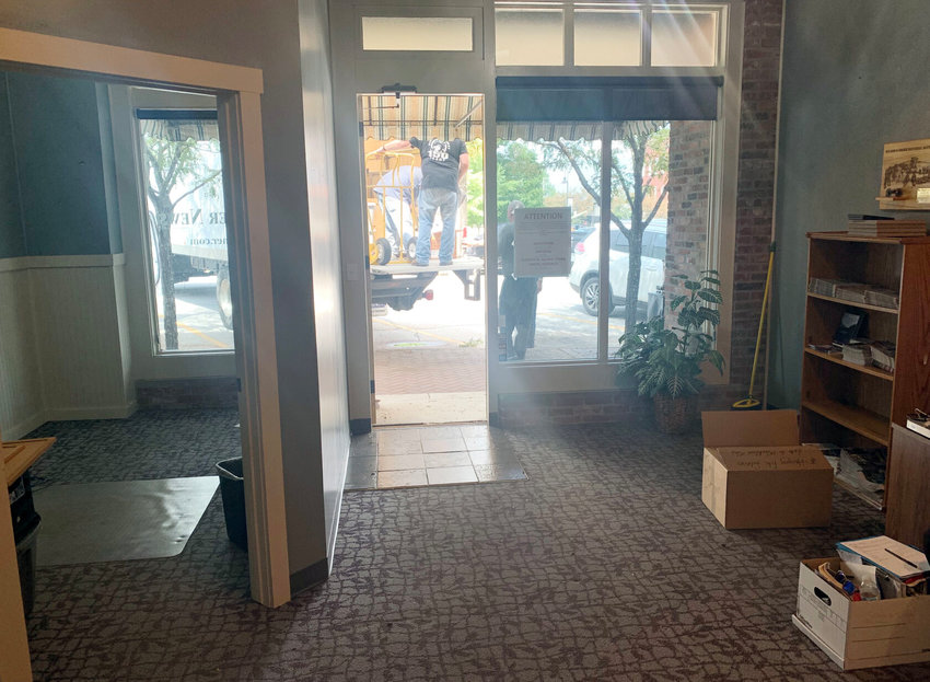 Workers move office furniture from the office of the Christian County Headliner News at 114 North Second Avenue in Ozark on July 20, 2020. The newspaper will cease to operate from a physical office in Ozark as of Aug. 1, 2020.