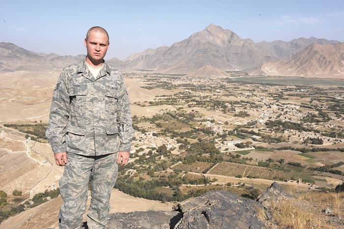 Submitted photoStaff Sgt. Mike Davis, an Air Force broadcaster, stands amidst a desert backdrop on his way to shoot a news story on the Afghan National Military Hospital in Kabul, Afghanistan.