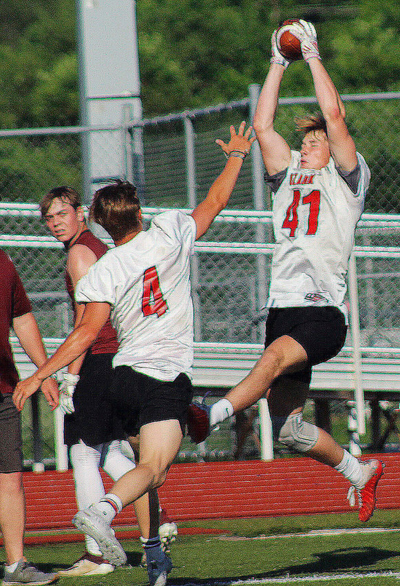 OZARK'S RYAN DOTSON hauls in a reception during 7-on-7 action.