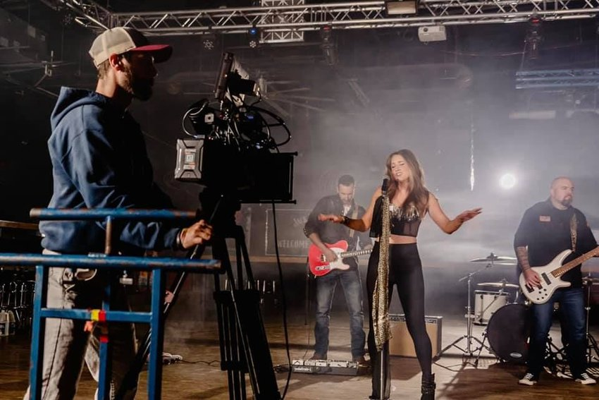 """Chelsey James sings """"The Men and the Boys"""" as shown behind-the-scenes during the shoot for the song's music video in Springfield."""