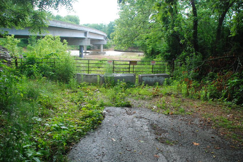 METAL GATES AND CONCRETE BARRICADES have blocked visitors from accessing the Finely River from Canyon Road in Christian County since March 8, 2020.