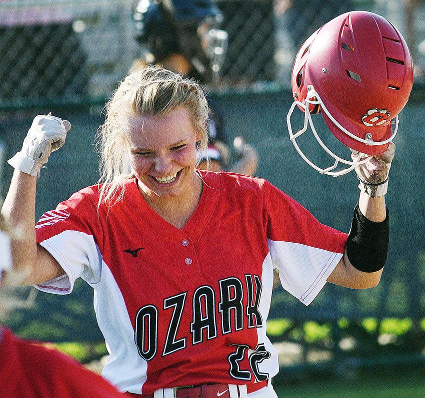 OZARK'S SAVANNAH HUGHES celebrates her two-run home run at Branson on Tuesday.