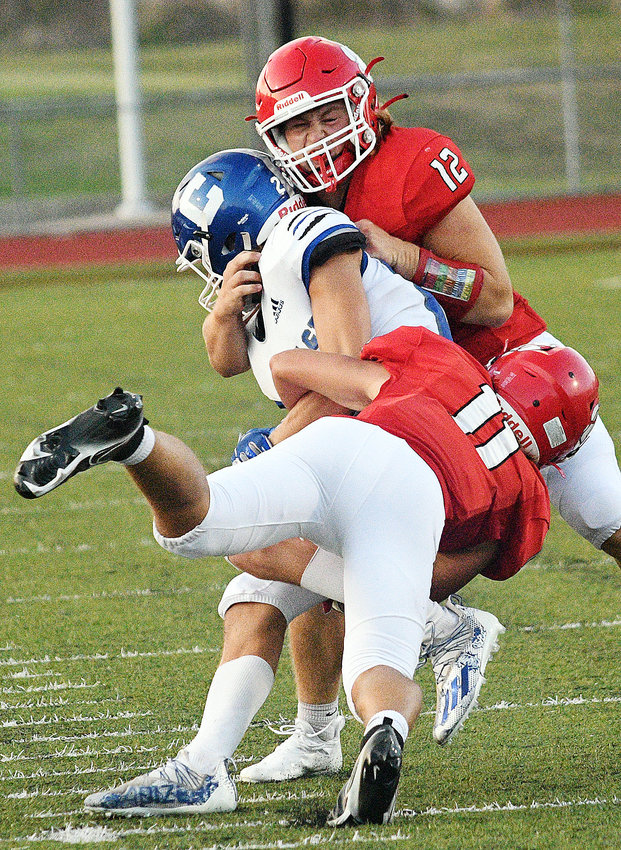OZARK'S GAGE DEPEE gets in on a tackle against Carthage earlier this season.