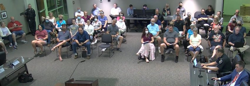NIXA CITY HALL was crowded with visitors on Sept. 13 for a Nixa City Council meeting. Citizens expressed their support and their disdain for a mayoral recall election to be held on Nov. 2.
