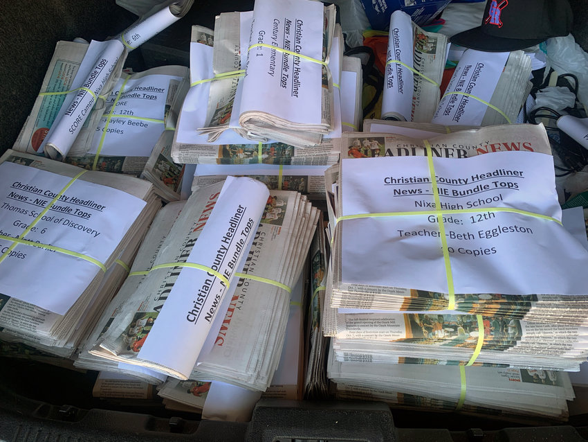 Newspapers for the Newspapers in Education program sit in the trunk of a car waiting to be delivered to schools in Ozark and Nixa on a Wednesday morning.