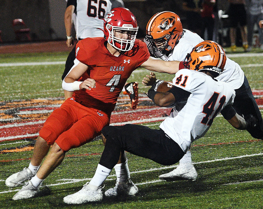 OZARK'S COOPER BUVID shakes off a block and tackles a Republic ball-carrier Friday.