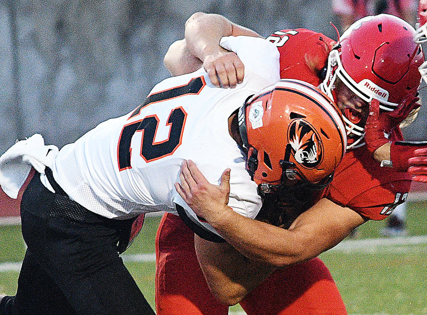 OZARK'S DREW BLOMQUIST tackles a Republic ball-carrier during the teams' matchup Friday.
