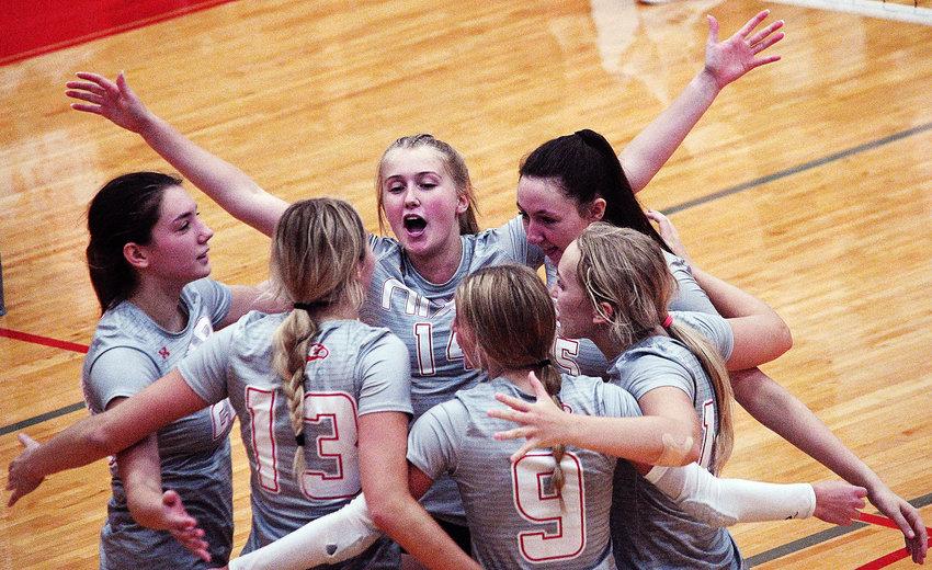 NIXA'S ALLIE BILLMYER celebrates the Lady Eagles' win over Ozark last week with her teammates.