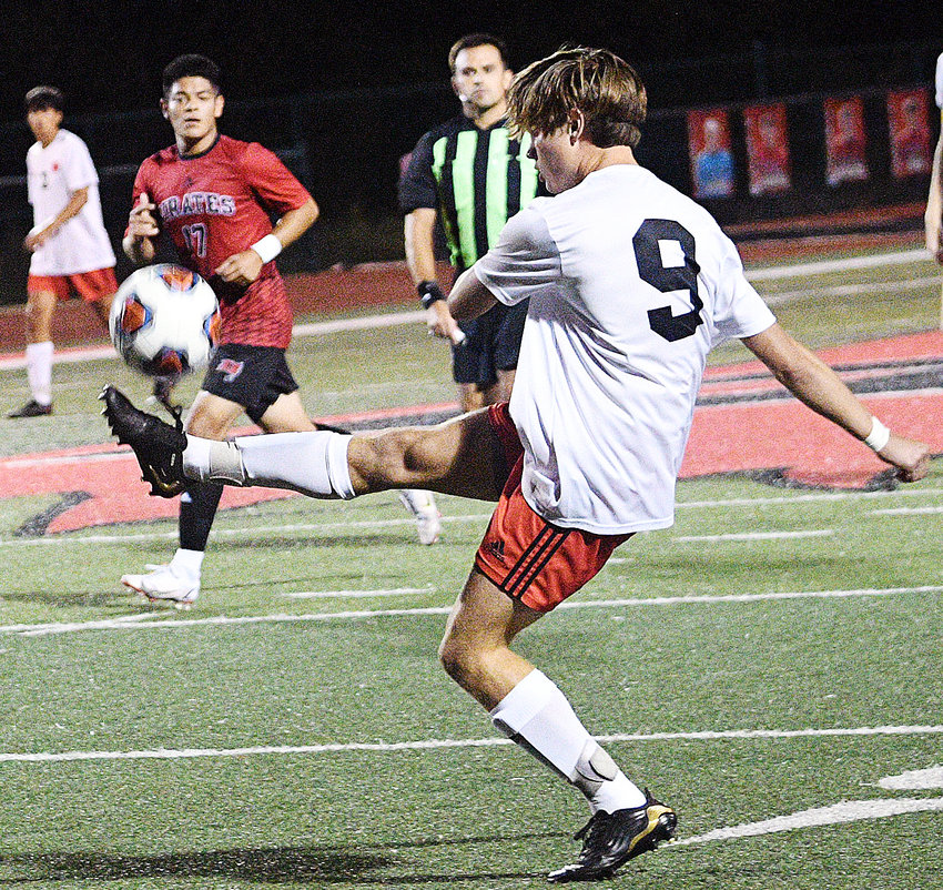 OZARK'S ETHAN PEEPLES gains control of the ball during the Tigers' 4-2 loss to Branson on Tuesday.