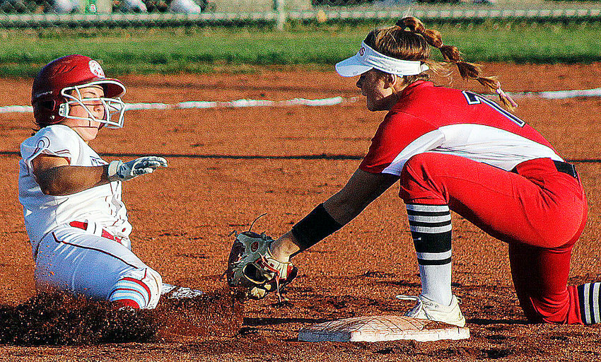 OZARK'S KAYLEE LINNEBURR tags out a Glendale runner at second base Tuesday in Class 5 District 11 action at Nixa.