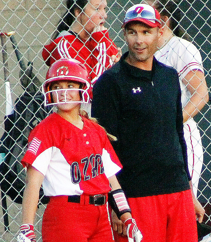 OZARK'S KENNA MAYFIELD and assistant coach Adam Erickson are all smiles after Mayfield's fourth hit against Glendale on Tuesday.