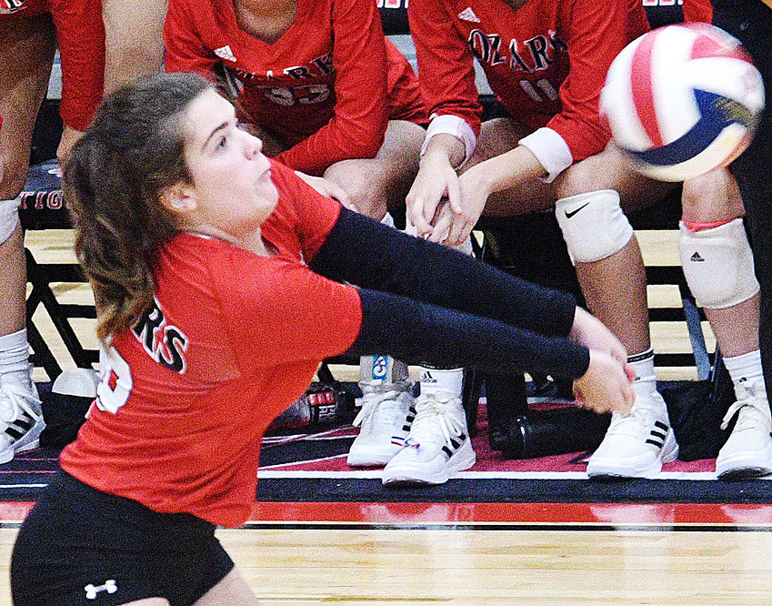 OZARK'S ANNA HOWE looks to set up a teammate at the net versus Willard on Tuesday.