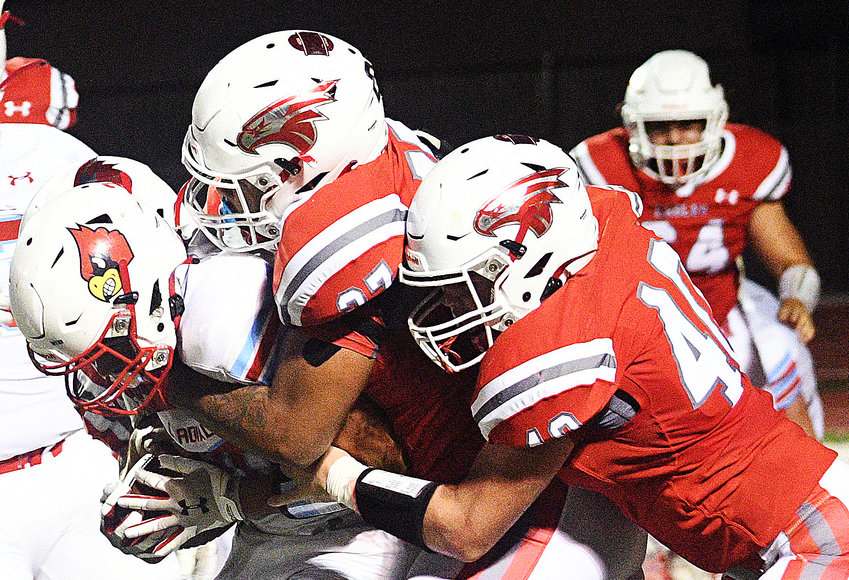 NIXA'S JADEN AVEN AND TY HARTMAN team up to stop a Webb City ball-carrier two weeks ago.