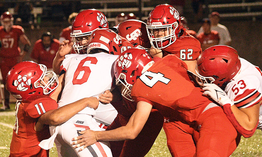 OZARK'S GAGE DEPEE AND COOPER BUVID combine for a tackle versus Carl Junction on Friday.