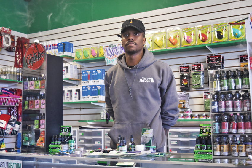 Assistant manager of The Haven smokeshop on Saginaw Highway, Theodore Blackwell, takes CBD for an injured knee.