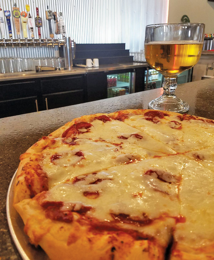 A classic combination: pizza and beer at Art's Pub.