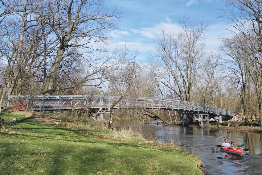 The winter's most ambitious trails project is a longer and higher bridge in a heavily used stretch of trail crossing the Red Cedar River near Potter Park Zoo.